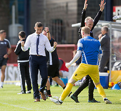 Ross County's manager Jim McIntrye cele Christopher Routis (4) scoring their second goal. Dundee 1 v 2 Ross County, Scottish Premiership game played 5/8/2017 at Dundee's home ground Dens Park.