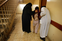 Zeynep Kamil, 11, recovers from burn wounds at Al Noor Hospital, Baghdad, Iraq, March 2, 2004. At least two suicide bombers blew themselves up outside of Al-Kadhimiya Mosque in Baghdad, where thousands of Shia Muslims had gathered to celebrate the Ashura religious festival. In what coalition authorities said was a coordinated attack, several bombs exploded in the holy city of Karbala as well, where an estimated two million Shias from Iraq, Iran, Pakistan and as far away as Canada had gathered for the holiday, which commemorates the martyrdom of Imam Hussein, grandson of the Prophet Mohammed. At least 143 people were killed in the combined attacks.