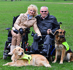 Crufts 2013 launch of annual dog show. The Kennel Club announces the official finalists of the Crufts dog heroes competition, Friends for Life, recognising pooches that help in war zones and assist the disabled. Green Park, The Kennel Club, London, United Kingdom..-Sue Harvey and Max, Byron Harvey and Ziggy.  Sue was isolated and on the verge of giving up because of her life threatening disabilities, including a brain tumour and spinal meningitis.  Inka, her first assistance dog helped her through until she died prematurely.  Byron, who had been in a wheelchair since boyhood due to Polio, tragically lost his childhood sweetheart.  It was his assistance dog, Isis, related to Sue's original assistance dog Inka, that brought the pair together.  Their love for each other grew through getting their new assistance dogs, Max and Ziggy, and they are they are soon married.  They are now a happy family., London, United Kingdom, February 21, 2013. Photo by Nils Jorgensen / i-Images.