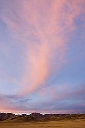 South America, Peru, dramatic cloud over arid hills near Ayaviri