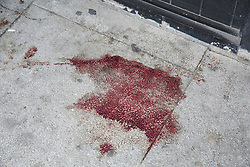 © Licensed to London News Pictures. 25/04/2019. London, UK. Blood stains outside Hill's New Point newsagent on Leytonstone High Road, Waltham Forest in East London. Two men were stabbed multiple times at a bus stop next to Hill's New Point newsagent close to Leytonstone High Road overground station just before 8pm on Wednesday 24 April 2019. A man in his 20s remains in a hospital in a critical condition. Photo credit: Dinendra Haria/LNP