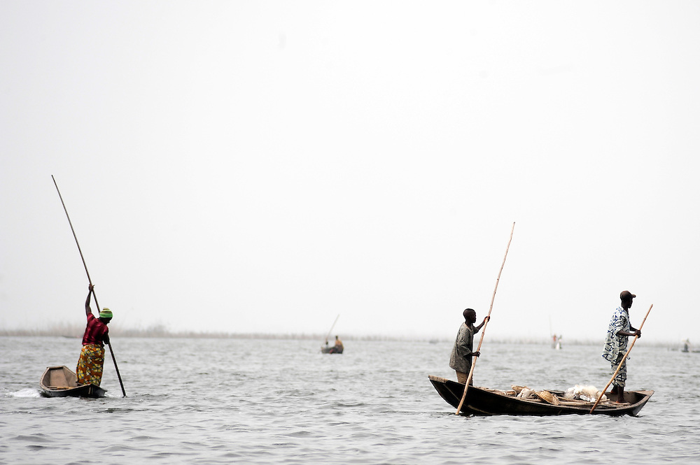 Benin March 1, 2008 Beninese fishermen work from their pirogues at dawn on the lagoon of Ganvie