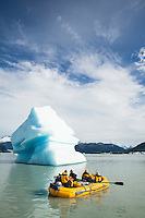 "Rowing accross Lake Alsek past ice bergs while on a raft trip down the Tashenshini River. The ""Tat"" flows out of Yukon, CA, through British Columbia and empties into Glacier Bay National Park in Alaska, US."