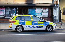 © Licensed to London News Pictures. 01/07/2020. London, UK. A police car is parked outside a block of flats in Monarch Parade in Mitcham, south London after a four year old girl was found seriously injured yesterday. She was taken to hospital where she later died. A woman, aged 35, is fighting for her life after she was also found suffering serious injuries inside the property. Photo credit: Peter Macdiarmid/LNP
