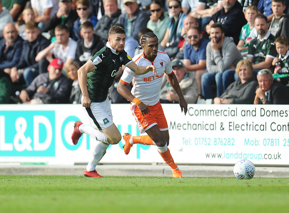 Blackpool's Nathan Delfouneso vies for possession with Plymouth Argyle's Joe Riley<br /> <br /> Photographer Kevin Barnes/CameraSport<br /> <br /> The EFL Sky Bet League One - Plymouth Argyle v Blackpool - Saturday 15th September 2018 - Home Park - Plymouth<br /> <br /> World Copyright © 2018 CameraSport. All rights reserved. 43 Linden Ave. Countesthorpe. Leicester. England. LE8 5PG - Tel: +44 (0) 116 277 4147 - admin@camerasport.com - www.camerasport.com