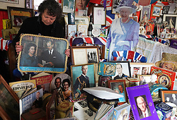 Anita Atkinson arranging the Queen and the Duke of Edinburgh's section of her royal memorabilia collection, one of the biggest in the world, at her home in Crook, County Durham. The 64 year old says she was devastated to hear the news of the death of Prince Philip. Picture date: Tuesday April 13, 2021.