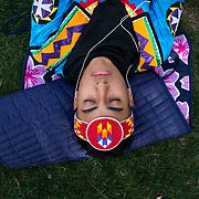 Talon Duncan (San Carlos Apache/Mandan/Hidatsa/Arikara, Mesa, Arizona, 1st place teen) takes a break before the final round, February 14, 2016, during the 26th annual Heard Museum World Championship Hoop Dance Contest, Phoenix, Arizona.