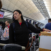 Vanessa Mae Rodel (42) checks in her bags in Hong Kong International Airport on March 25, 2019, before flying to Canada. / Photo: Maria de la Guardia