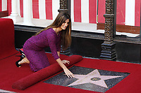 4/1/2010 Penelope Cruz poses by her Hollywood Walk of Fame ceremony
