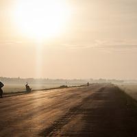 A road through rice paddies near Hue, Vietnam.