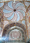 Stunning photographs reveal the beautiful ceilings in Iran's mosques, bazaars and public baths<br /> <br /> For the past few decades, restrictions on travel to Iran has meant the country has been largely shut off from the Western world, butas visa sanctions are lifted in the light of a landmark nuclear deal, the local tourism industry is hoping for a flurry of visitors.<br /> It's not hard to see why Iran is listed as one of the top travel destinations of 2016, with its rich culture and history.<br /> Among the standout aspects of the nation is its beautiful ancient architecture, with the cities and towns littered withornate and eye-catching mosques, public baths and markets.<br /> And unlike many other countries - the roof is not an afterthought, with many ceilings built as the centrepiece to the building, with many of the tile designs showcasing a display of intricate geometric patternsthatdate back several centuries.<br /> French photographerEric Lafforgue has travelled the country photographing the ceilings of indoor markets, mosques and bath houses.<br /> <br /> Photo shows: elaborate decorations of the meditation room of the tomb of shah nematollah vali, Kerman province, Mahan, Iran