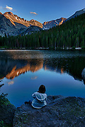 USA, Colorado, Rocky Mountain National Park,  photographer at Bear Lake at sunset, digital composite, HDR