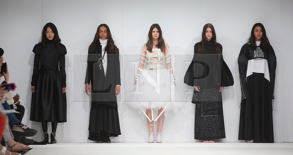 © Licensed to London News Pictures. 02/06/2015. London, UK. Collection by Collection by Carl Frederik Knudsen and Christopher Strangeby of Moteskolen as Esmod Oslo. Samsonite International Catwalk Competition takes place during Graduate Fashion Week 2015. Graduate Fashion Week takes place from 30 May to 2 June 2015 at the Old Truman Brewery, Brick Lane. Photo credit : Bettina Strenske/LNP