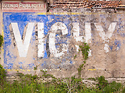 Faded sign in the Dordogne region of France