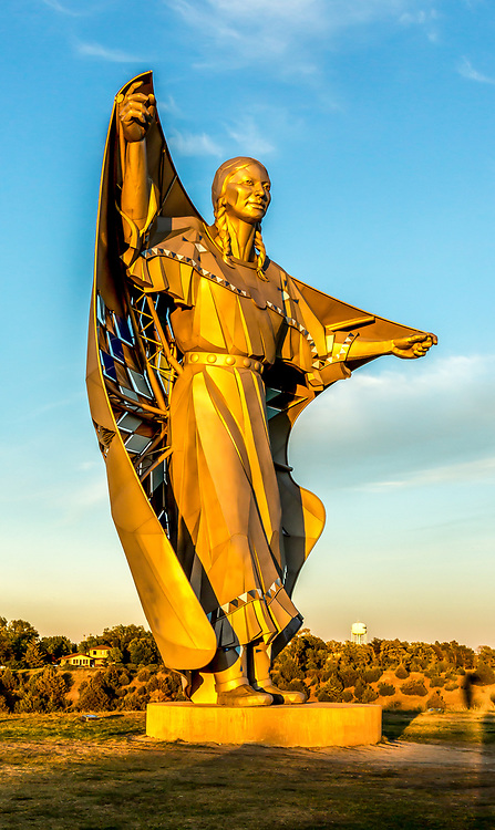 Dignity sculpture on a bluff overlooking the Missouri River near Chamberlain, South Dakota. The 50-foot high stainless steel statue depicts an Indigenous woman in Plains-style dress receiving a star quilt.  According to South Dakota artist laureate Dale Lamphere, the sculpture honors the culture of the Lakota and Dakota peoples who are indigenous to South Dakota.The statue was erected in September 2016 at a site off Interstate 90. Photo taken September 27, 2017.