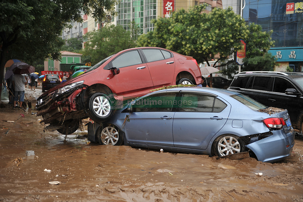 July 27, 2017 - Stacked cars after a flood in Suide county of Yulin city, northwest China's Shaanxi Province. Six people are reported dead in a rain-triggered flood, local authorities said. (Credit Image: © Zhang Bowen/Xinhua via ZUMA Wire)