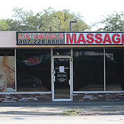 The Lucky Dragon massage parlor remains empty due to the non-essential business order placed by the Orange County Government on Saturday, March 28, 2020 in Orlando, Florida. (Alex Menendez via AP)