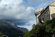 Parapet of  Kula Kanavelic (aka Tower Bokar or Tower Barbarigo), Croatian mainland in background. Korcula old town, island of Korcula, Croatia