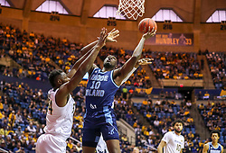Dec 1, 2019; Morgantown, WV, USA; Rhode Island Rams forward Cyril Langevine (10) shoots in the lane during the first half against the West Virginia Mountaineers at WVU Coliseum. Mandatory Credit: Ben Queen-USA TODAY Sports