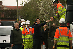 © Licensed to London News Pictures. 04/04/2014. Somerset, UK Prime Minister David Cameron visits flood hit Moorland in Somerset with MP Ian liddell-Grainger. Photo credit : Jason Bryant/LNP