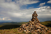 A cairn marks the highest point on the Top of the World Highway, Yukon Territory, Canada.