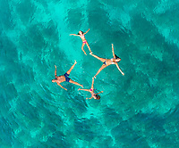 Aerial view of family of 4 playing in Adriatic sea, Sutivan, Croatia.