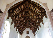 Historic interior of Bedingfield church, Suffolk, England, UK wooden hammer beam roof