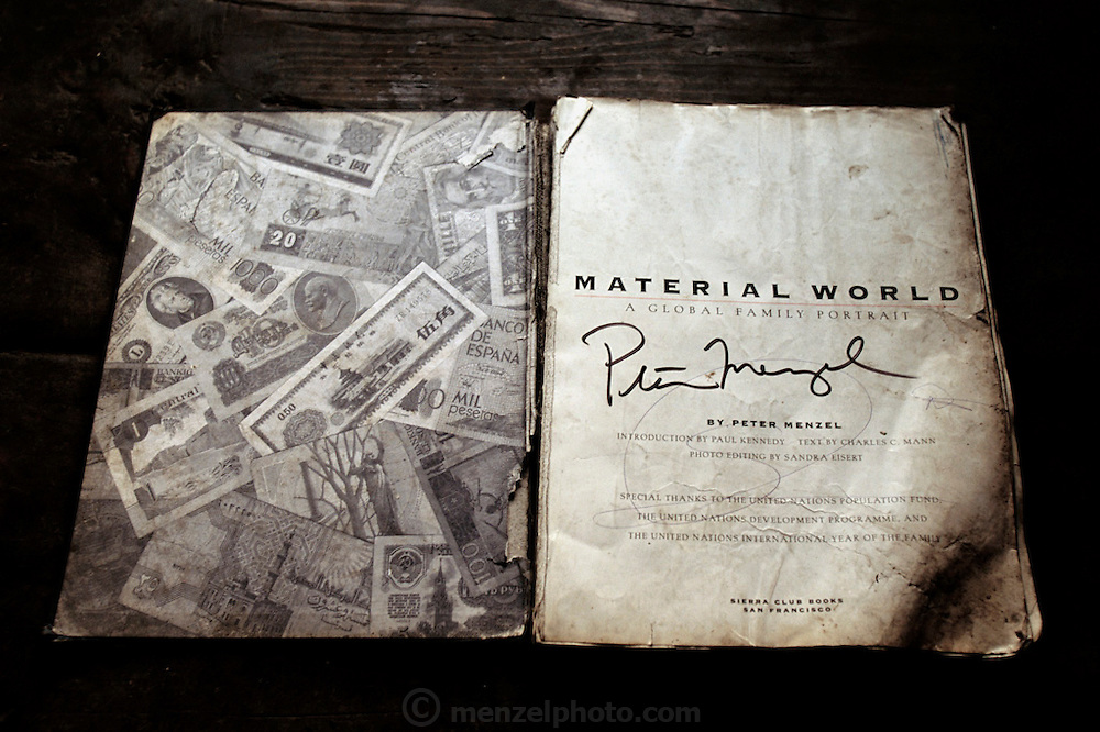 Well-worn and water damaged copy of Material World: A Global Family Portrait that was given (new) to Nalim and Namgay's family after it was published in 1994. From coverage of revisit to Material World Project family in Bhutan, 2001.