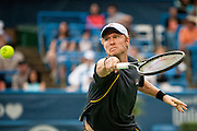 Russia's Dmitry Tursunov hits a return to USA's John Isner during their men's semifinals singles match at the Citi Open ATP tennis tournament in Washington, DC, USA, 3 Aug 2013.  Isner won the match 6-7, 6-3, 6-4 to advance to the final on Sunday.