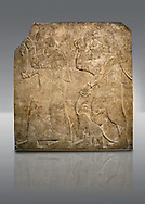 Assyrian relief sculpture panel  of Tribute bearers, the first one has a turban from north-west Syria and raises his clenched hands as a token of submission. The second person may be Phoenician and has a pair of monkeys to add the Assyrian kings exotic animal collection .  From Nimrud, Iraq,  865-860 B.C North West Palace. Court D, panel 7.  British Museum Assyrian  Archaeological exhibit no WA 124502. .<br /> <br /> If you prefer to buy from our ALAMY PHOTO LIBRARY  Collection visit : https://www.alamy.com/portfolio/paul-williams-funkystock/ancient-assyria-antiquities.html  Refine search by adding background colour, place, subject, museum etc into the LOWER SEARCH WITHIN GALLERY box to <br /> <br /> Visit our ANCIENT ASSYRIAN PHOTO COLLECTIONS for more photos to download or buy as wall art prints https://funkystock.photoshelter.com/gallery-collection/Ancient-Assyrian-Art-Artefacts-Antiquities-Historic-Sites-Pictures-Images-of/C0000cjRqQyJjLag