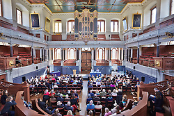 © Licensed to London News Pictures.  22/03/2014. OXFORD, UK. James Naughtie, Radio 4 Today programme presenter and author, speaking at an Oxford Literary Festival event in the Sheldonian Theatre about his new thriller The Madness of July. <br /> <br /> In this picture: Paul Blezard (left on stage) and James Naughtie (right on stage) <br /> <br /> Photo credit: Cliff Hide/LNP