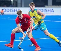 BHUBANESWAR, INDIA -  Will Calnan (Eng) with Eddie Ockenden (Aus)   , England v Australia for the bronze medal during the Odisha World Cup Hockey for men  in the Kalinga Stadion.   COPYRIGHT KOEN SUYK