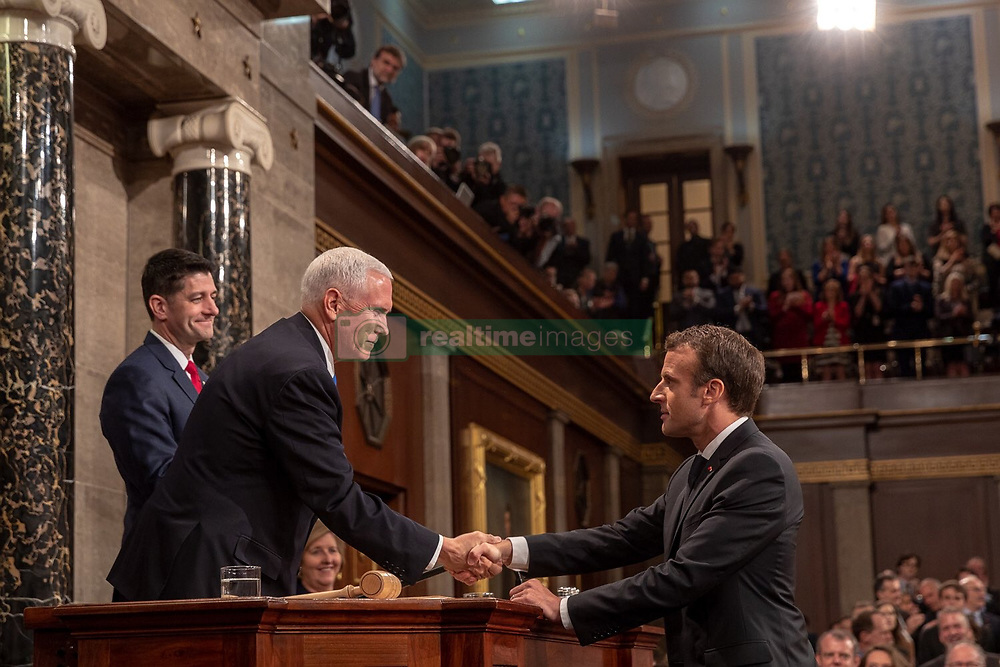 April 25, 2018 - Washington, DC, United States of America - U.S Vice President Mike Pence, left, shakes hands with French President Emmanuel Macron as Speaker Paul Ryan looks on following an address to a joint session of Congress April 25, 2018 in Washington, DC.  Macron is on a State Visit to Washington, the first since President Trump took office. (Credit Image: © D. Myles Cullen/Planet Pix via ZUMA Wire)
