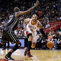 29 January 2012: Chicago Bulls power forward Carlos Boozer (5) drives past Miami Heat center Joel Anthony (50) during the Miami Heat 97-93 victory over the Chicago Bulls at the AmericanAirlines Arena, Miami, Florida, USA.