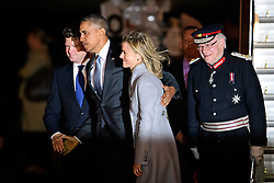 © London News Pictures. 21/04/2016. Stansted, UK. President of the United States BARACK OBAMA is greeted by United States Ambassador to the United Kingdom MATTHEW BARZUN (left) and is wife BROOKE BROWN (centre) and Lord-Lieutenant of Essex, the Lord Petre, as he arrives at Stansted Airport in Essex, UK, for the start of his UK visit.. President Obama will meet the Queen for lunch at Windsor Castle, and also holds talks with Prime Minister David Cameron. Photo credit: Ben Cawthra/LNP