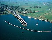 Nederland, Amsterdam, Waterland, 17-10-2005; luchtfoto (25% toeslag); water van het Buiten-IJ met Noordelijke ingang ingang van de Zeeburgertunnel onder Buiten-IJ, met aan de horizon het begin van de regio Waterland; infrastructuur, ruimtelijke ordening, landschap.Foto Siebe Swart