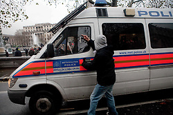 © Under license to London News Picures. A student directs a gesture towards police during protests against increased tuition fees for students in London today (30/11/2010) This is the third student day of action. Photo credit should read: Fuat Akyuz/London News Pictures