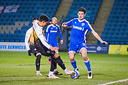 Gillingham FC midfielder Thomas O'Connor (21) and Crewe Alexandra defender Travis Johnson (23) battles for possession during the EFL Sky Bet League 1 match between Gillingham and Crewe Alexandra at the MEMS Priestfield Stadium, Gillingham, England on 26 January 2021.