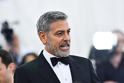 George Clooney walking the red carpet at The Metropolitan Museum of Art Costume Institute Benefit celebrating the opening of Heavenly Bodies : Fashion and the Catholic Imagination held at The Metropolitan Museum of Art  in New York, NY, on May 7, 2018. (Photo by Anthony Behar/Sipa USA)