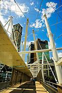 Brisbane's Kurilpa Bridge during the daytime underneath a blue sky