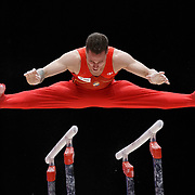 Nestor Abad of Spain performs on the Parallel Bars at the 46th FIG Artistic Gymnastics World Championships in Glasgow, Britain, 25 October 2015.