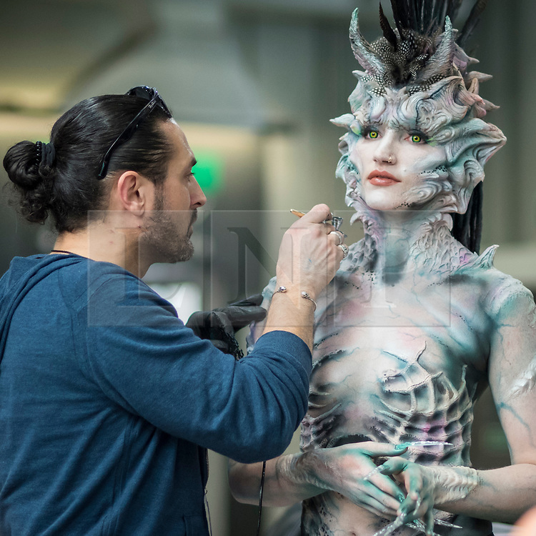© Licensed to London News Pictures. 18/05/2019. LONDON, UK.  A make-up artist works on a model at the International Make-Up Artists Trade Show (IMATS) taking place at Kensington Olympia 16 to 19 May 2019.  The show brings together make-up artists from around the world, including those with Hollywood movie backgrounds, providing classes in theatre, film, TV, fashion and editorial make-up to professionals and enthusiasts.  Photo credit: Stephen Chung/LNP