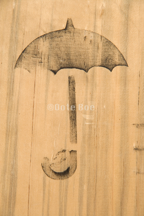umbrella shipping symbol painted on a wooden background