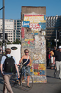 some parts of the old wall  have become symbolic street decor in theultramodern Postdamerplatz
