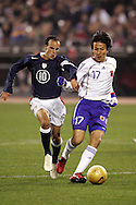10 February 2006: Landon Donovan (10), of the U.S., chases Japan's Makoto Hasebe (17). The United States Men's National Team defeated Japan 3-2 at SBC Park in San Francisco, California in an International Friendly soccer match.