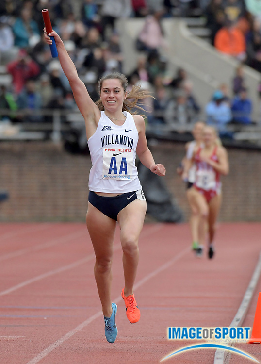 Apr 27, 2018; Philadelphia, PA, USA; Nicole Hutchinson celebrates after running the anchor leg on the Villanova women's 4 x 1,500m relay that won the Championship of America race in 17:35.48 during the 124th Penn Relays at Franklin Field.