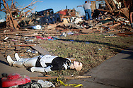 A Star Wars movie character mannequin lies outside a tornado destroyed house in Oklahoma City, Oklahoma May 22, 2013.  The owner of the house collected movie memorabilia. Rescue workers with sniffer dogs picked through the ruins on Wednesday to ensure no survivors remained buried after a deadly tornado left thousands homeless and trying to salvage what was left of their belongings.  REUTERS/Rick Wilking (UNITED STATES)