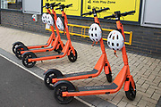 A row of orange Neuron Mobility e-scooters is pictured on 23 October 2020 in Slough, United Kingdom. Neuron Mobility have launched a rental trial in Slough allowing residents to hire 250 e-scooters using a smartphone app and to ride them in the borough's bus and on-road cycle lanes but not on any pavements including shared pavements.