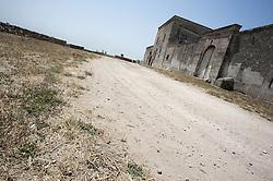 La Masseria è documentata come centro agricolo di riferimento sin dal XV secolo. Nel tempo ha attraversato notevoli cambiamenti di coltura, dalla vite all'ulivo, passando per seminativi e mandorleti. La storia agricola e la vocazione vitivinicola del terreno ove sorge Amastuola risalgono però all'epoca Magno-Greca, come testimoniano decenni di indagini archeologiche svolte sui suoi terreni. I greci sarebbero arrivati via mare, risalendo poi per un paio di chilometri sino alle sorgenti del fiume Tara. Da questa zona di acque sorgive - tutt'ora balneabili - ma all'epoca circondata da paludi, sarebbero poi risaliti per un altro paio di chilometri, raggiungendo il pianoro dell'Amastuola dove s'insediarono. Gli scavi archeologici hanno infatti portato alla luce in loco un insediamento magno-greco, circondato da un agger.