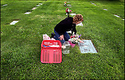 Steven St. John/Tribune..Dawn Sandoval visits the grave site where her daughter Lisa Marie is buried at Mountain View Cemetery on Monday October 10, 2005.